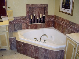 Bathroom example featuring a jacuzzi style corner bathtub