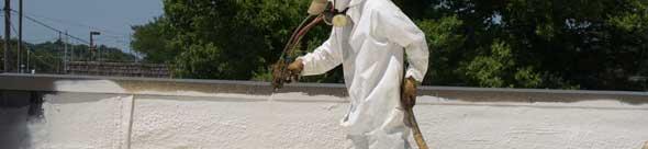 Administering  spray polyurethane foam system on roof