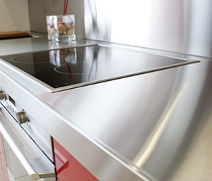 Example of stainless steel counter top with a built in smooth top stove