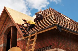 Contractors repairing a home after storm damage in Peoria IL